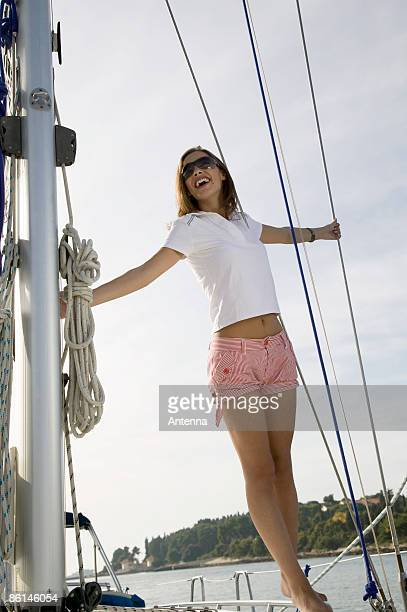 A woman standing on a yacht