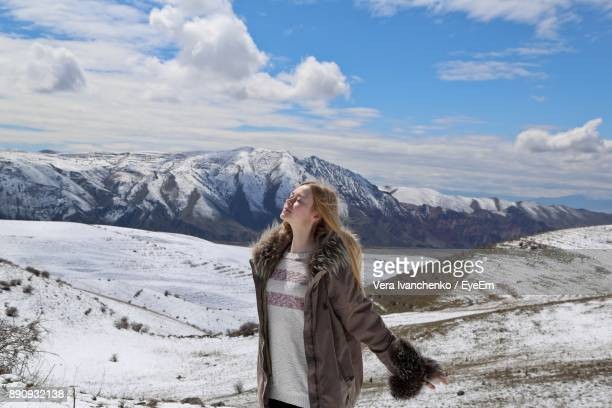 Woman Standing On Against Sky During Winter
