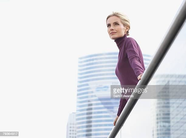 woman standing on balcony - viewpoint stock pictures, royalty-free photos & images