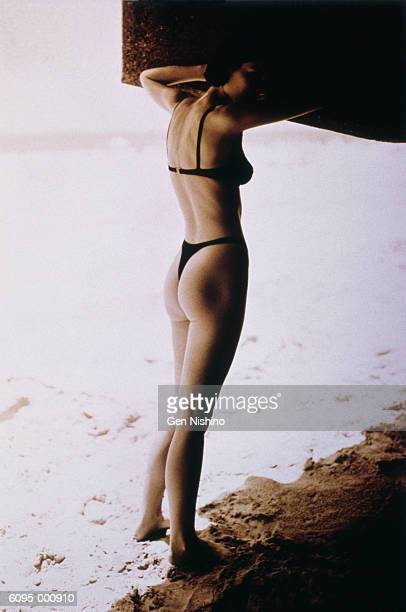 woman standing on beach - thong bikini stock pictures, royalty-free photos & images