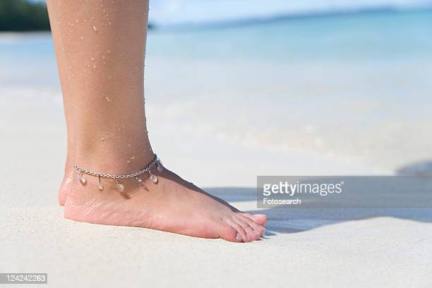 Woman standing on beach, Saipan, USA
