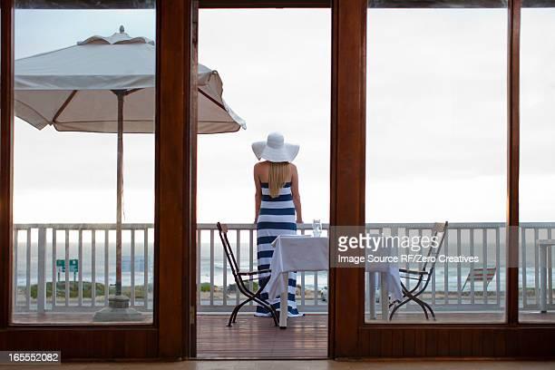 Woman standing on beachfront patio