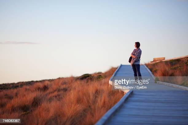 woman standing on boardwalk - kangaroo island stock photos and pictures