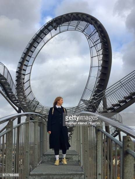 woman standing on bridge against spiral staircases - duisburg imagens e fotografias de stock