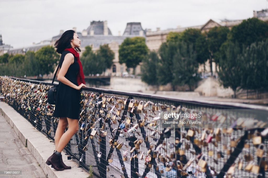 Woman Standing On Bridge In City : Stock Photo