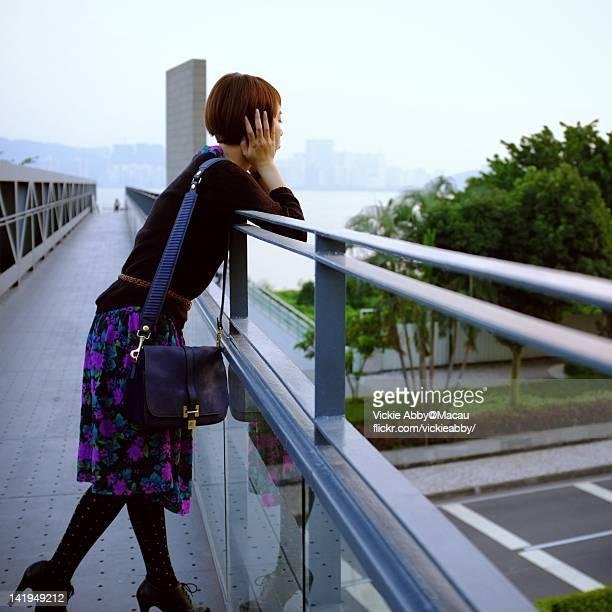 woman standing on bridge - macao fotografías e imágenes de stock