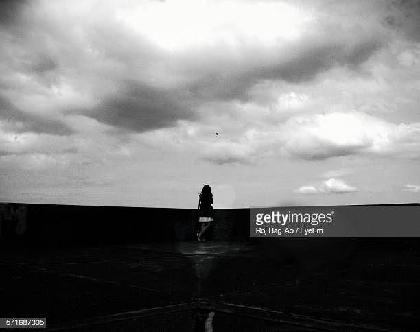 Woman Standing On Building Terrace