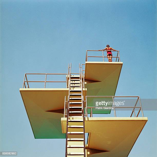 Woman Standing on Diving Platform