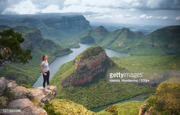 woman standing on edge of cliff, nelspruit, south africa - mpumalanga province stock pictures, royalty-free photos & images