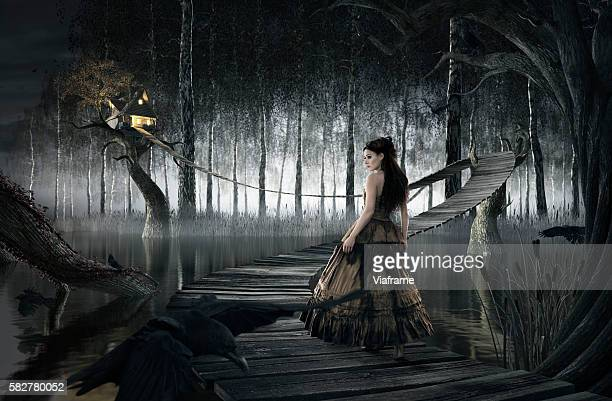 Woman standing on footbridge leading to treehouse (digital composite)