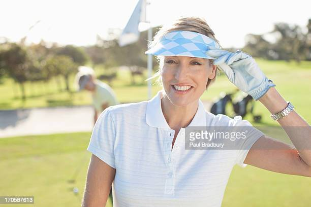 Woman standing on golf course