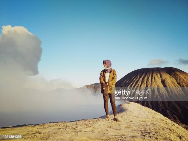 woman standing on land against sky - bromo tengger semeru national park stock pictures, royalty-free photos & images