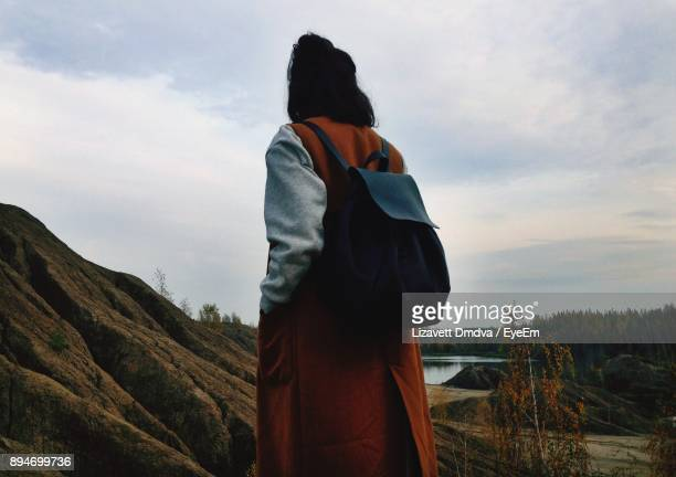 Woman Standing On Landscape Against Sky