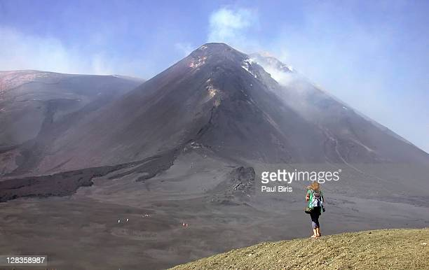 woman standing on mount etna - mt etna stock pictures, royalty-free photos & images
