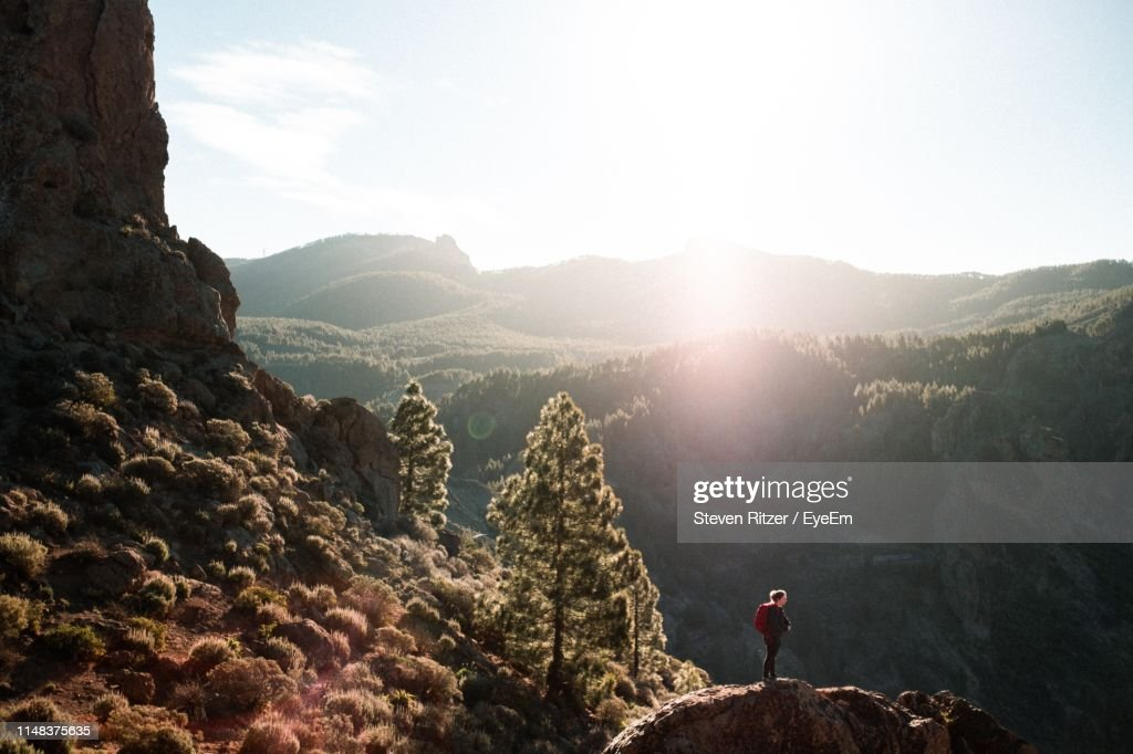 Woman Standing On Mountain Against Sky : Stock Photo