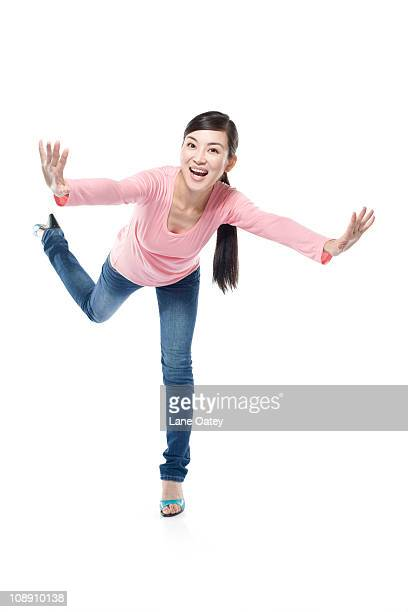 woman standing on one leg - standing on one leg stock pictures, royalty-free photos & images
