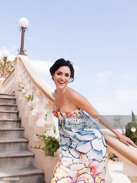 woman standing on outdoor staircase - lingering stock pictures, royalty-free photos & images