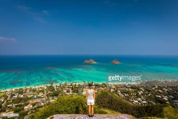 Woman standing on pillbox near Kailua.