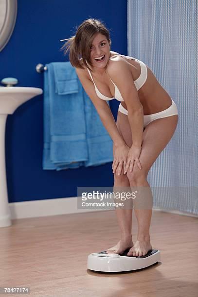 Woman standing on scale in underwear