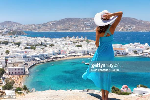 woman standing on shore in greece - islas griegas fotografías e imágenes de stock