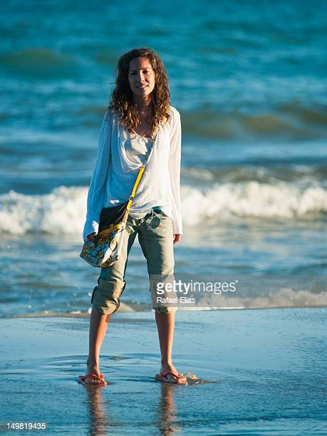 woman standing on shore - rolled up pants stock pictures, royalty-free photos & images