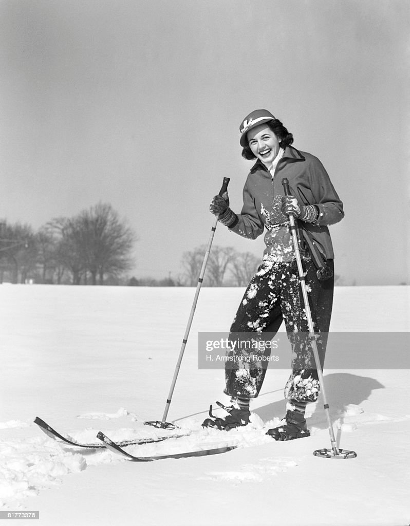 Woman Standing On Skis Smiling At Camera Ski Clothes Smiling Laughing Spattered With Snow From Fall. : Foto de stock