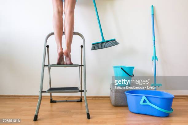 woman standing on step ladder - step ladder stock pictures, royalty-free photos & images
