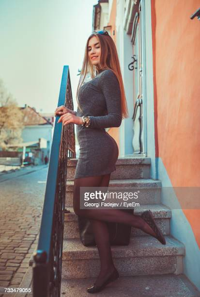 Woman Standing On Steps
