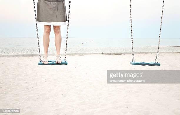 Woman standing on swing
