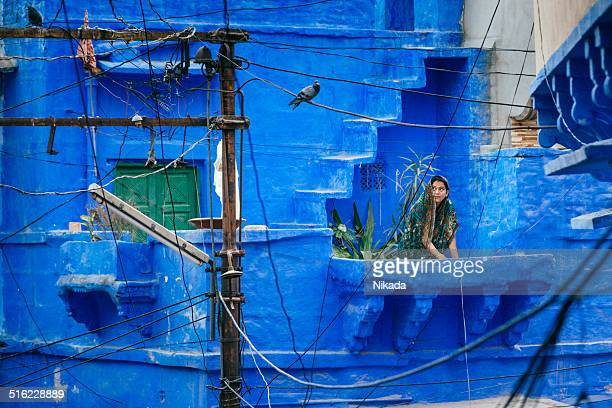 woman standing on the balcony in jodhpur, india - jodhpur stock pictures, royalty-free photos & images