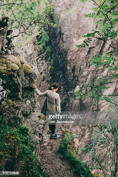 Woman standing on the edge of the rock