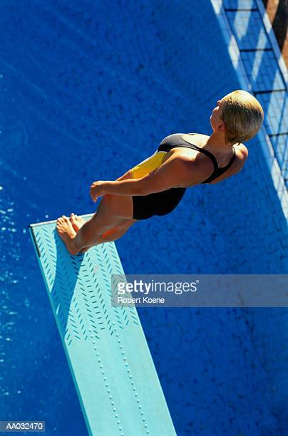Woman Standing on the End of a Diving Board