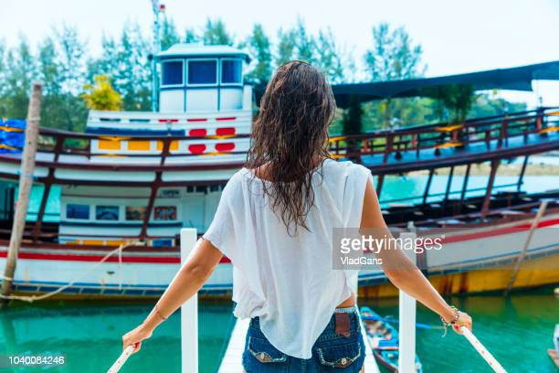 woman standing on the pier - vlad models stock pictures, royalty-free photos & images