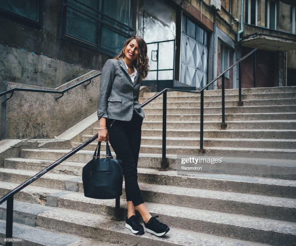 Woman standing on the stairs : Stock Photo