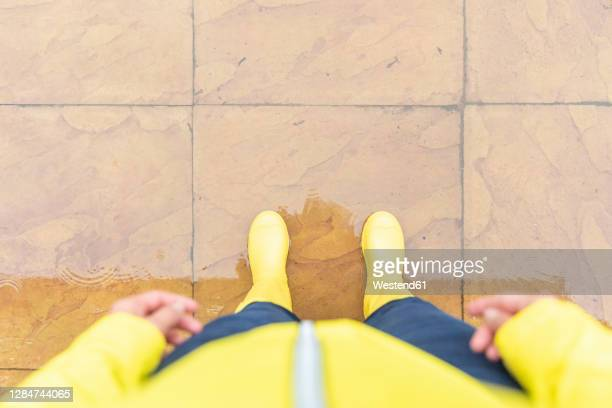 woman standing on tiled floor in back yard - standing stock pictures, royalty-free photos & images