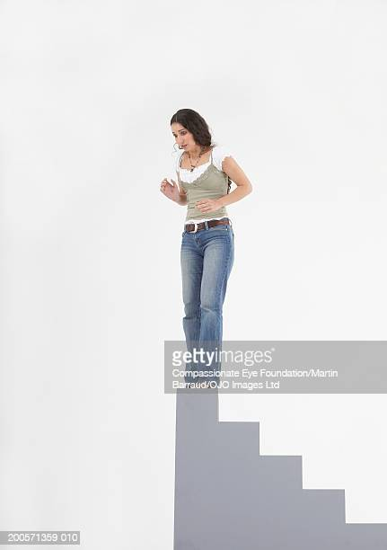 Woman standing on top of staircase block
