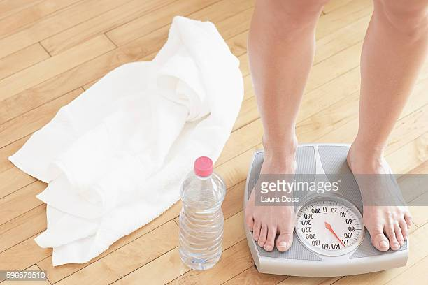 Woman standing on weight scale