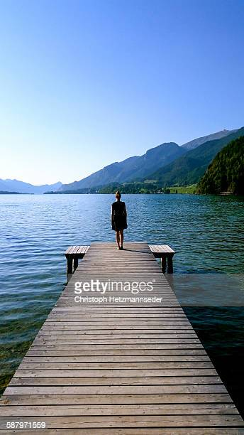 Woman standing on wood jetty