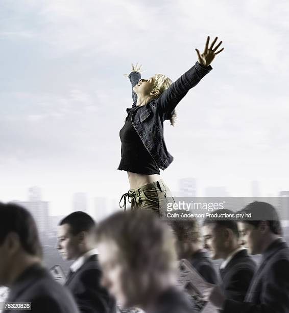 Woman standing out from crowd