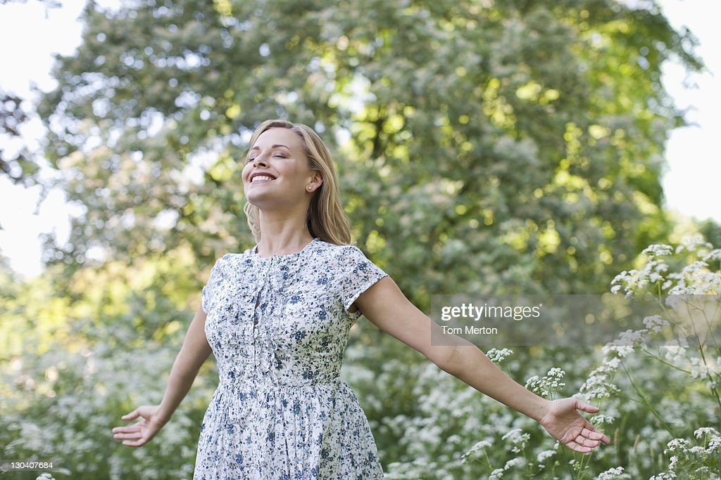 Woman standing outdoors : Stock Photo
