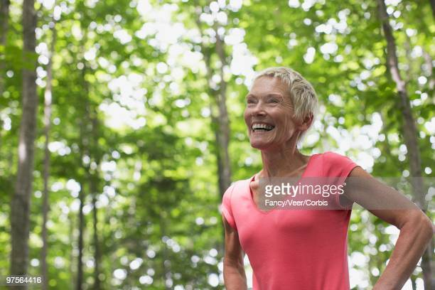 woman standing outdoors - wildnisgebiets name stock pictures, royalty-free photos & images