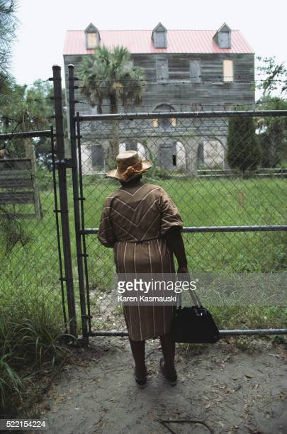 Woman Standing Outside Former Slave Plantation