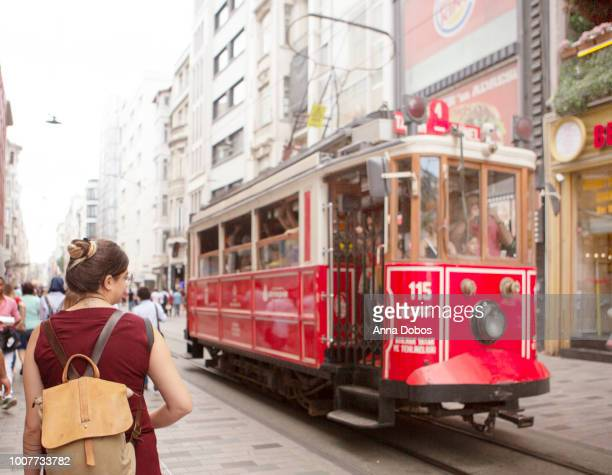 woman standing outside of taksim square trolly - istanbul province stock photos and pictures