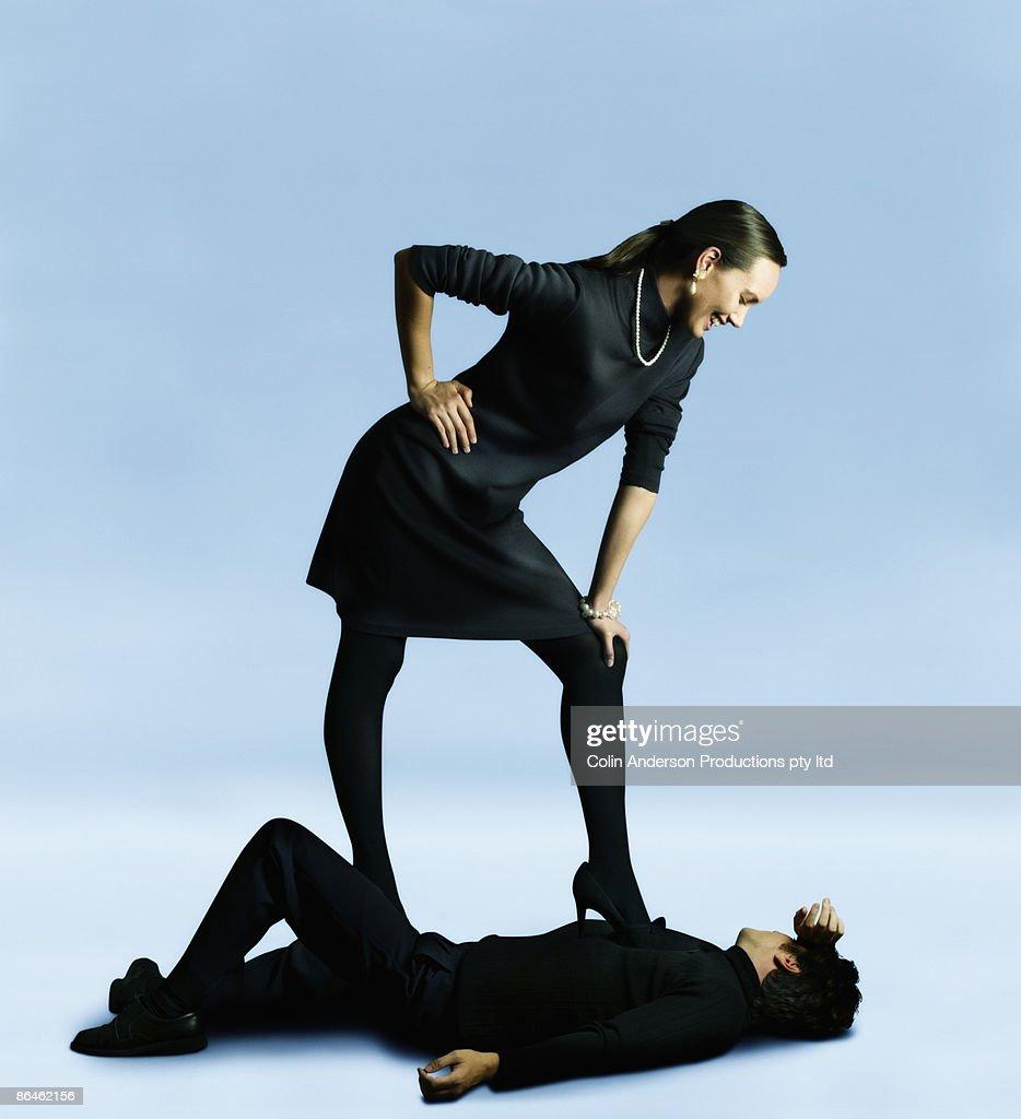 Woman Standing Over Man Woman Standing Over Ma...