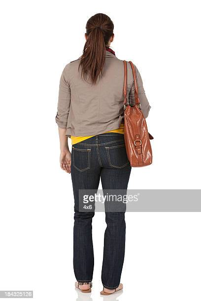 Woman standing with a bag