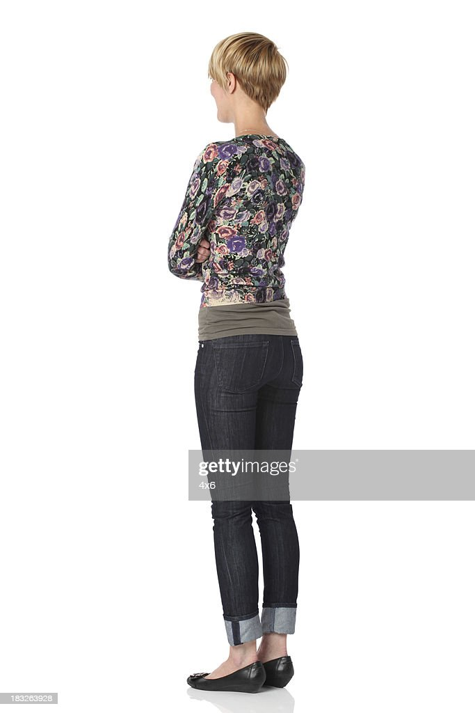 Woman standing with arms crossed : Stock Photo