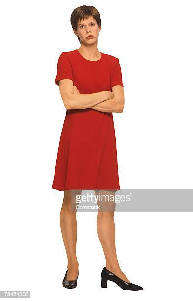 Woman standing with arms crossed , pouting