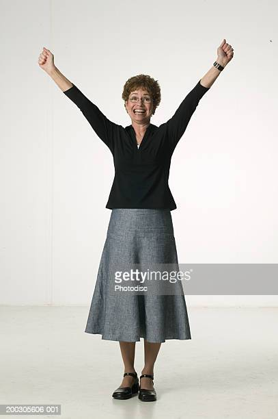 Woman standing with arms outstretched in studio