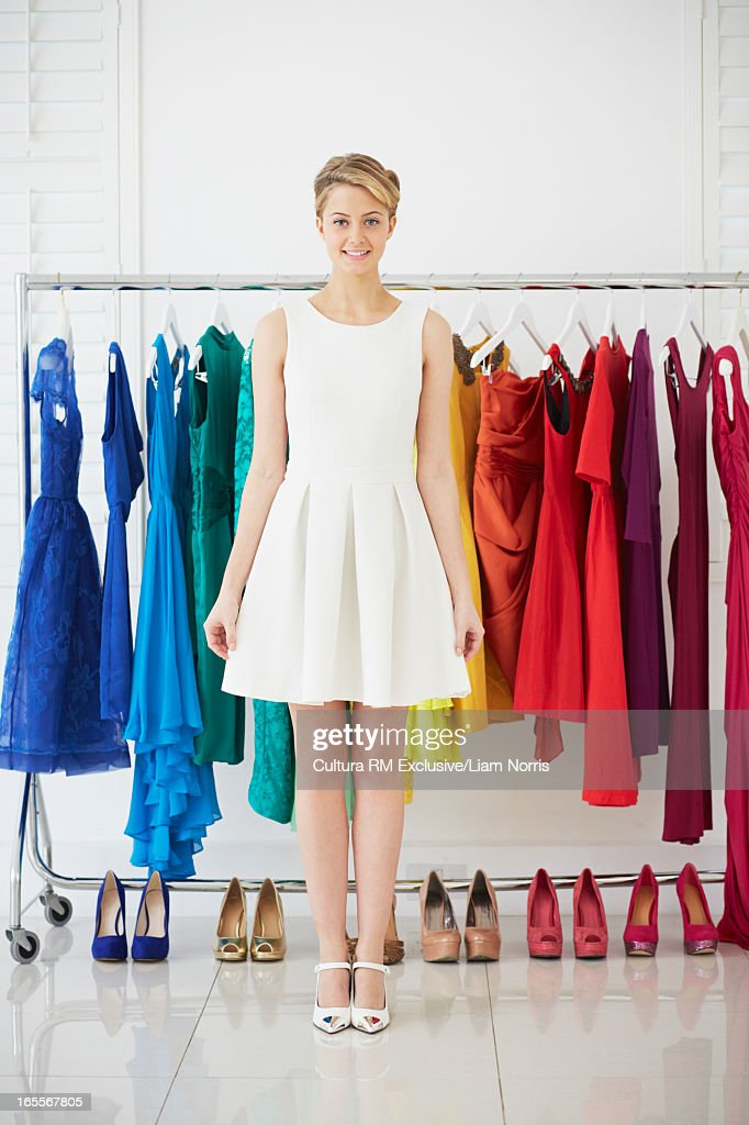 Woman standing with colorful wardrobe : Stock Photo