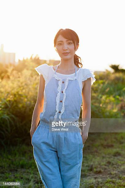 Woman standing with hands in pockets